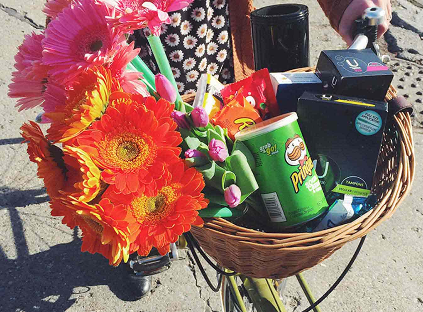 Bicycle basket of flowers, chips, U by Kotex