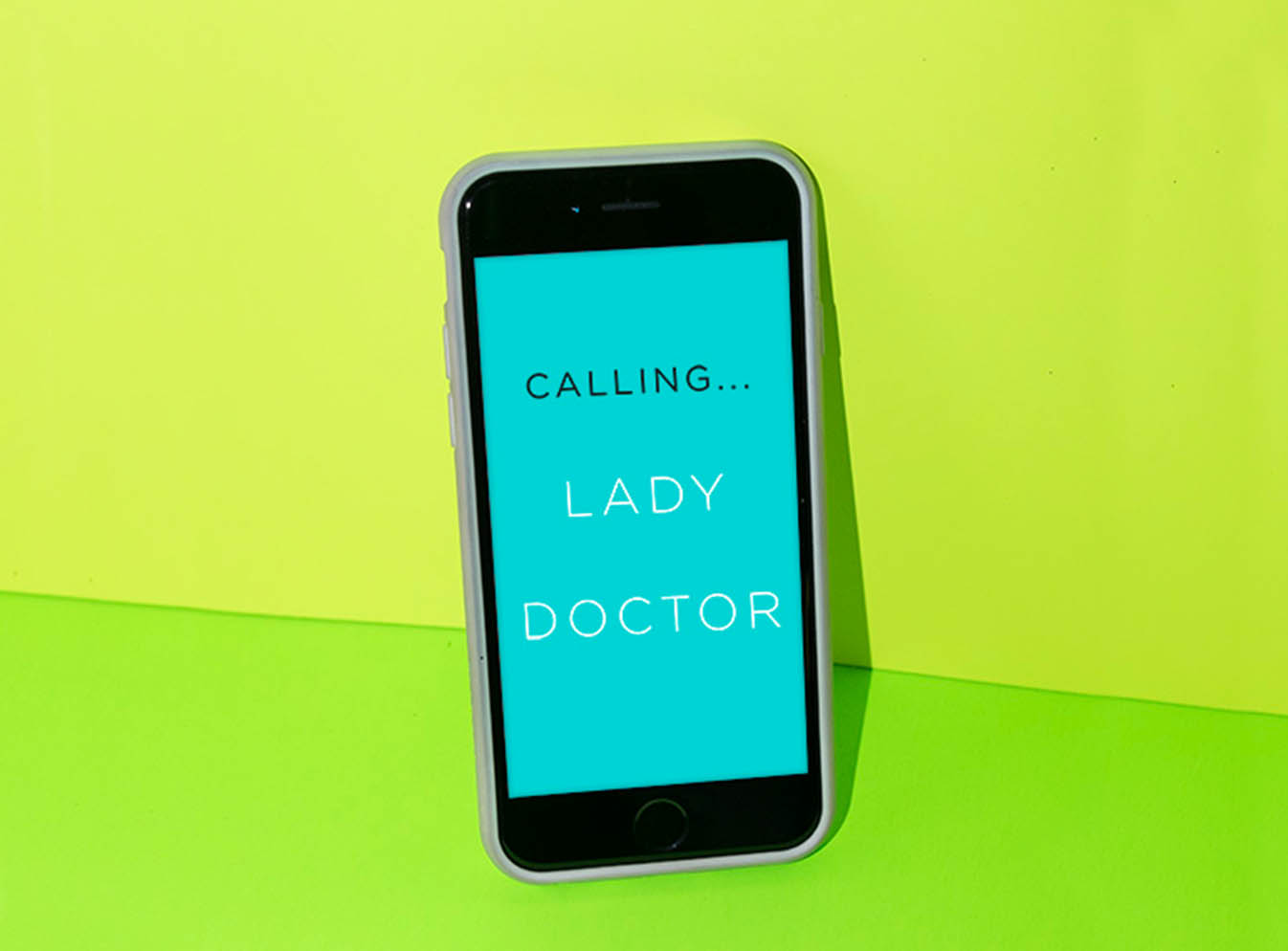 Mobile phone displaying Calling... Lady Doctor