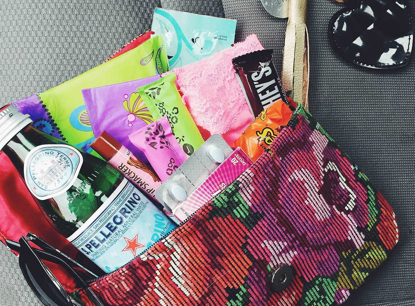 Purse with water, chocolate, liners, tampons