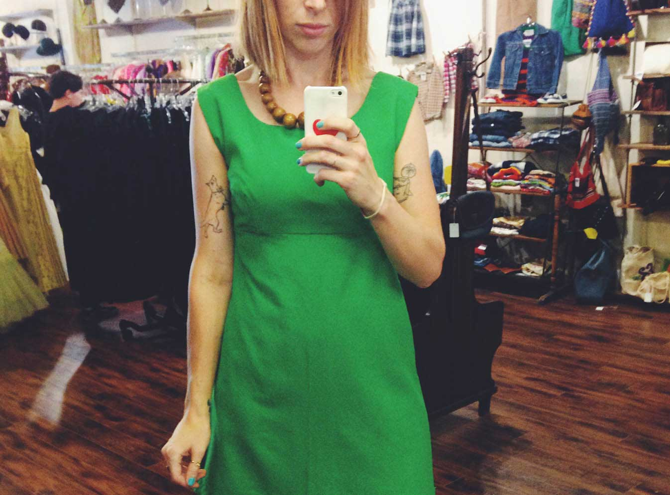 Girl in green dress taking a selfie