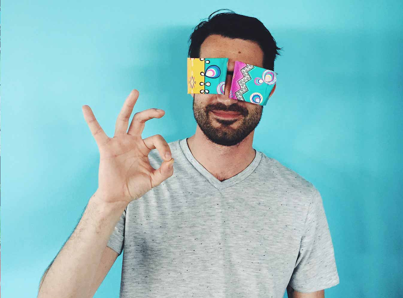 Man making OK sign with hand with liners over eyes