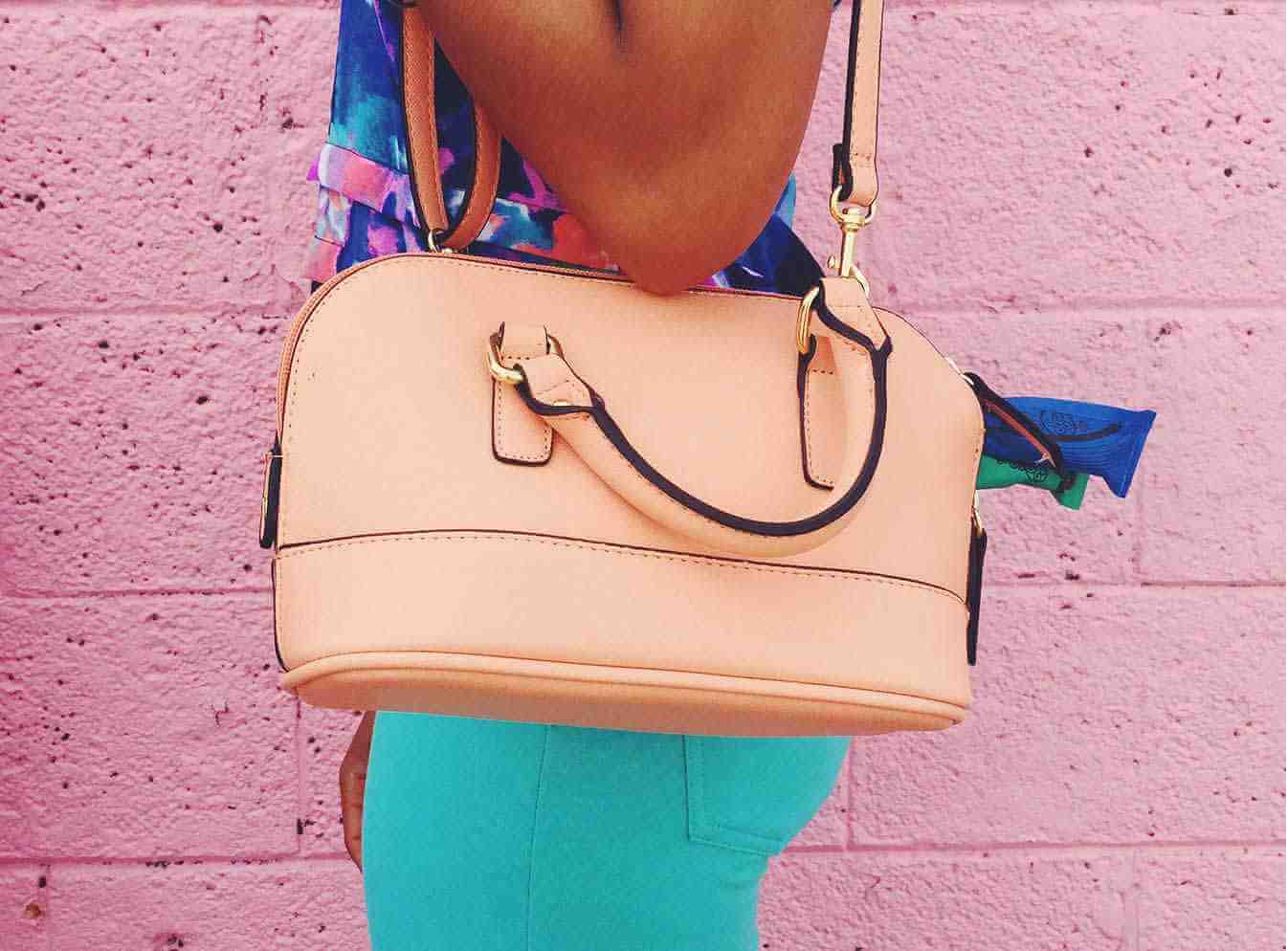 Peach shoulder bag with tampons