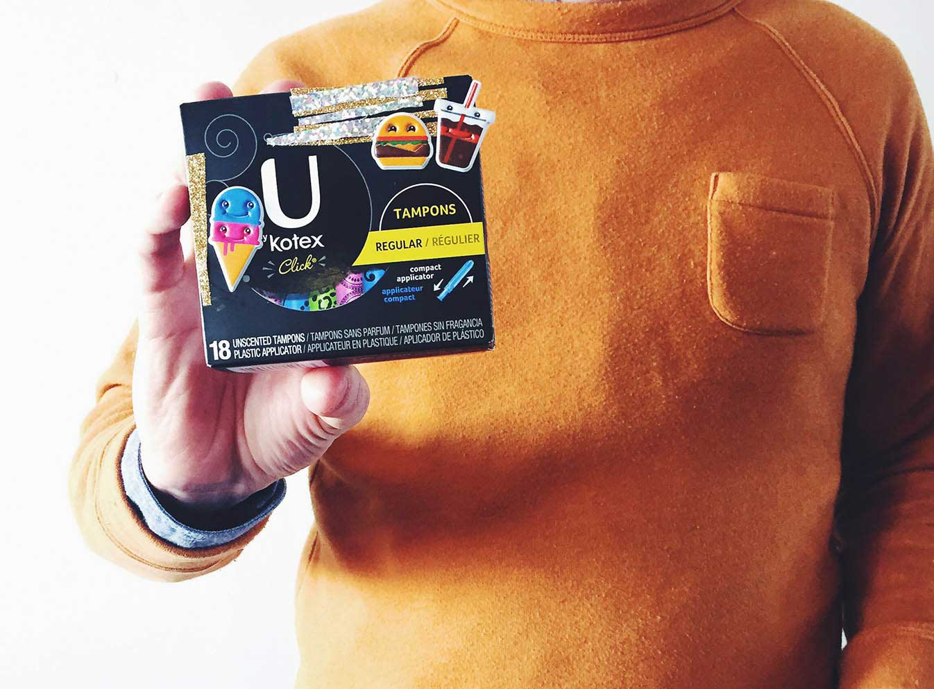 Hand holding up box of U by Kotex