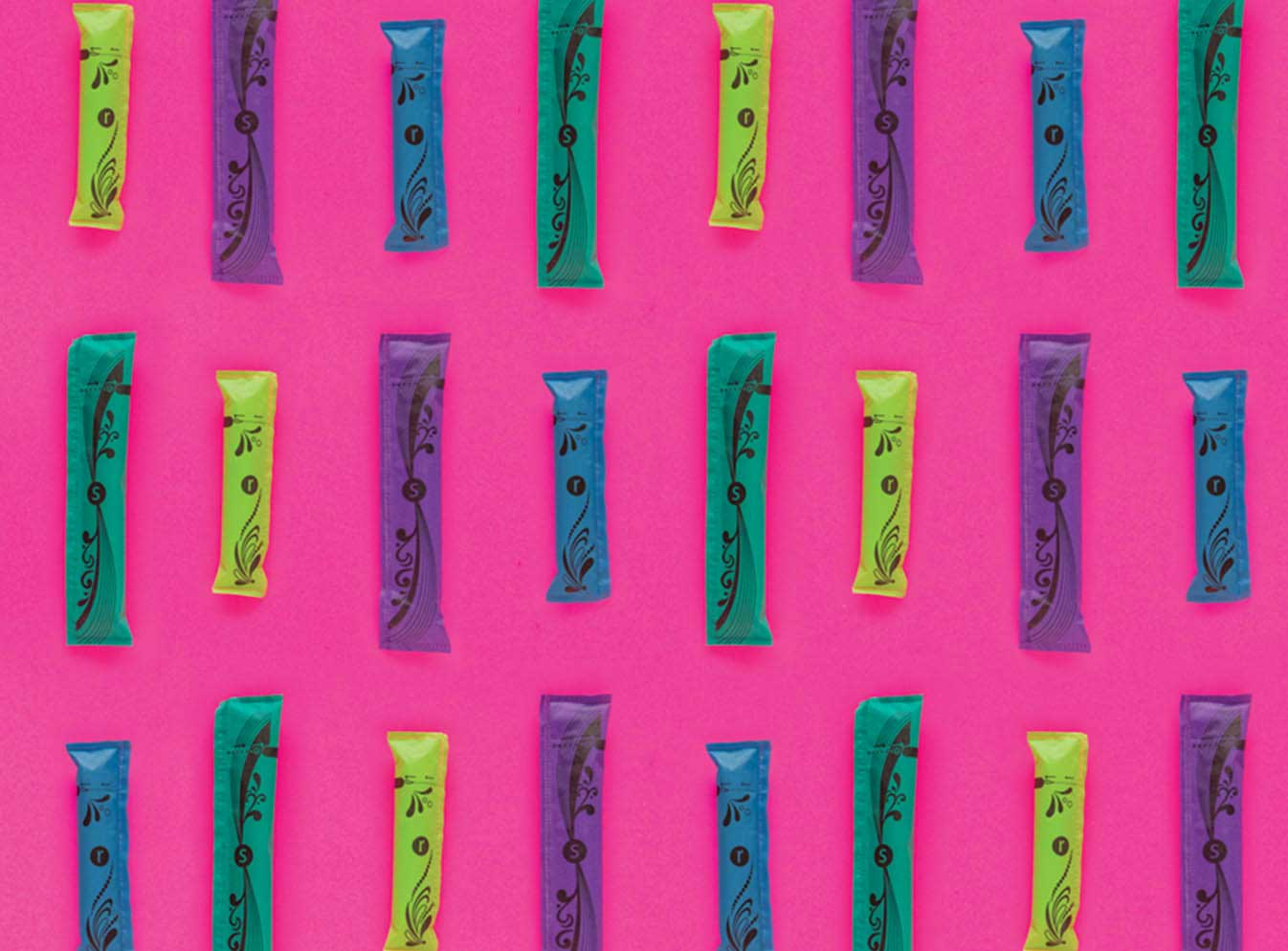 Row of tampons on pink background