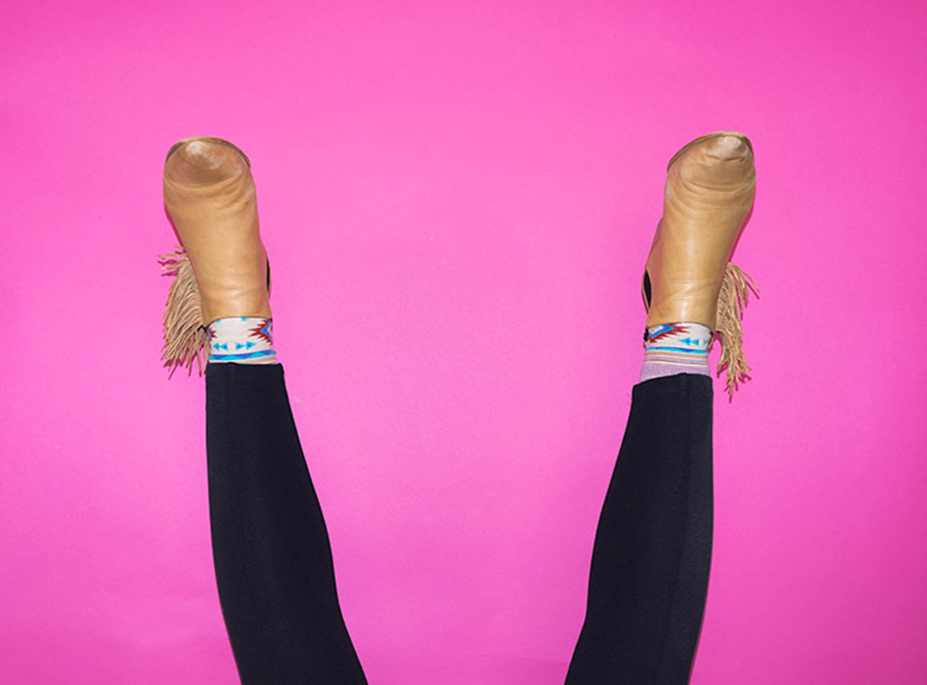 Legs on pink background